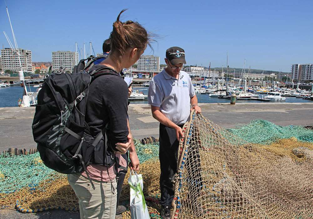 SNTech team talking to fisherman with net